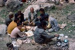 Communal breakfast prior to spring cleaning of irrigation canals in Boir Ahmad by Reinhold Loeffler