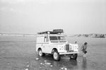 Loeffler daughter and vehicle traversing river in Boir Ahmad by Reinhold Loeffler
