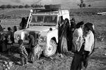 Villagers curious about fieldworker's vehicle, remote Boir Ahmad by Reinhold Loeffler