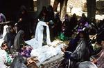 Preparing funeral shroud, Boir Ahmad village by Reinhold Loeffler