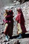 Girls chatting on a path in a Boir Ahmad village by Reinhold Loeffler