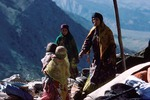 Transhumance pastoralists setting up a new campsite in Boir Ahmad by Reinhold Loeffler