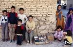 Boys selling wares in a village in Boir Ahmad by Reinhold Loeffler