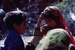 Girl and boy in a Boir Ahmad village by Reinhold Loeffler