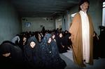 Highschool girls led in prayer by a mullah by Reinhold Loeffler