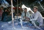 Men at tea in black tent of transhumance pastoralists, Boir Ahmad by Reinhold Loeffler