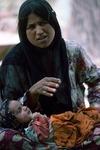 Mother tending her baby, Boir Ahmad by Reinhold Loeffler