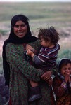 Portrait of a young woman with her children in Boir Ahmad by Reinhold Loeffler