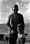 Portrait of man with son by Reinhold Loeffler
