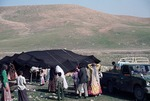 Bride led into tent of her husband's family by older women, rural Boir Ahmad by Reinhold Loeffler