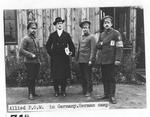 YMCA War Prisoners' Aid Secretary with Russian POW's