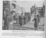 Russian POWs Sweep a Street in Russian Poland