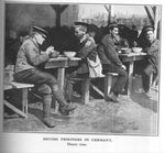 British POWs Eat Dinner in a German Prison Camp